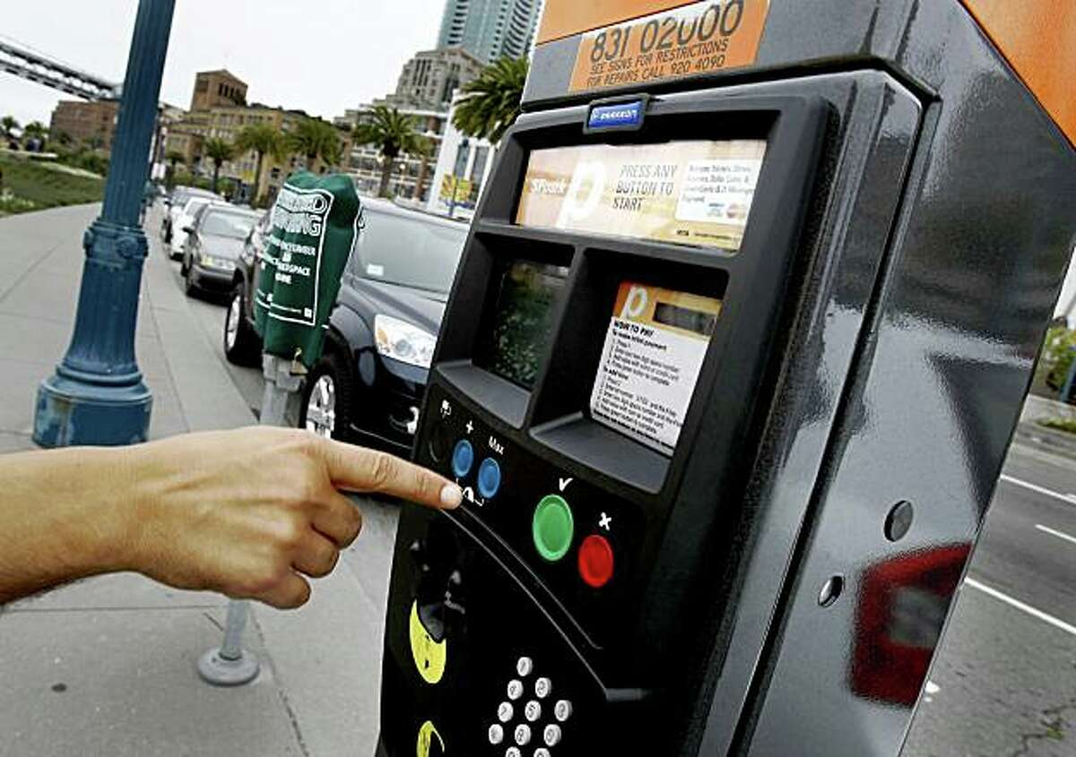 A man pushed several buttons and put several quarters in, but walked away frustrated. San Francisco is testing out new multi-space parking meters which accept credit cards and coins on the Embarcadero. People seem confused when the machine does not issue a receipt.