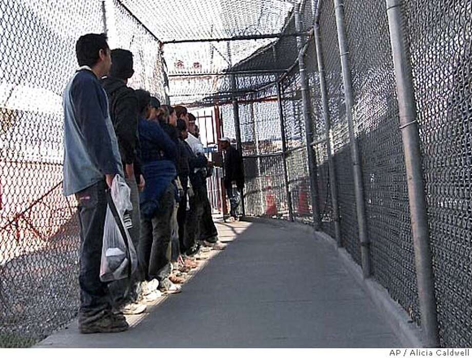 ###Live Caption:Illegal immigrants from Mexico wait in a holding area in El Paso, Texas, Thursday, May 1, 2008. U.S. Border Patrol agents have discretion to send illegal immigrants home instead of throwing them in jail. In some cases, they do it over and over and over. (AP Photo/Alicia Caldwell)###Caption History:Illegal immigrants from Mexico wait in a holding area in El Paso, Texas, Thursday, May 1, 2008. U.S. Border Patrol agents have discretion to send illegal immigrants home instead of throwing them in jail. In some cases, they do it over and over and over. (AP Photo/Alicia Caldwell)###Notes:###Special Instructions:BEST QUALITY AVAILABLE Photo: Alicia Caldwell