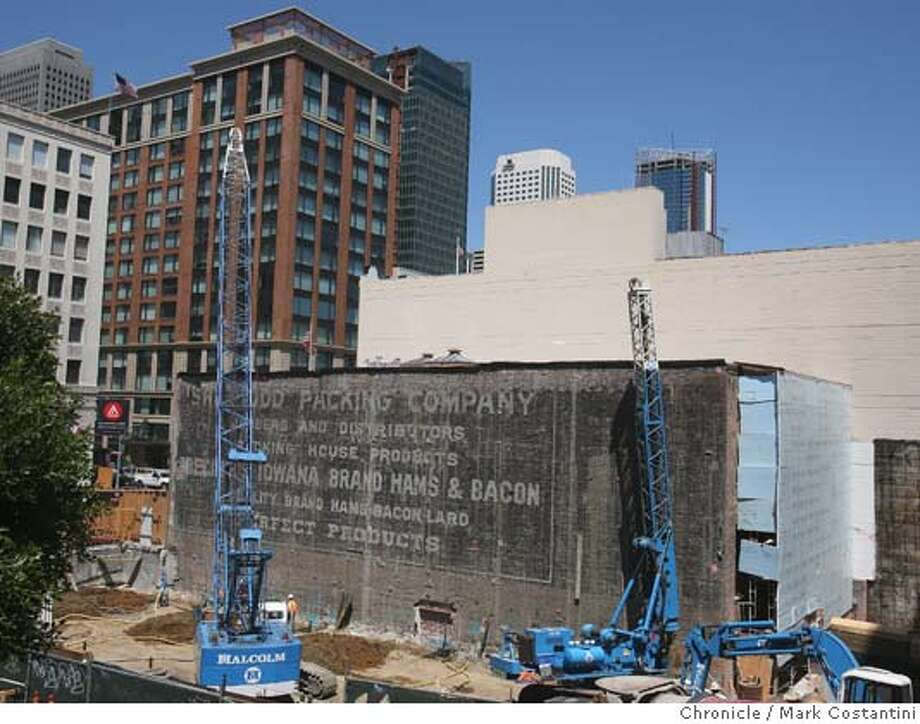 �A brick wall on Hawthorne St. is exposed for now because of a condo project, that bears an advertisement for Lard and Packing House Products on May 1, 2008 in San Francisco, Calif. Photo by Mark Costantini / San Francisco Chronicle. Photo: Mark Costantini