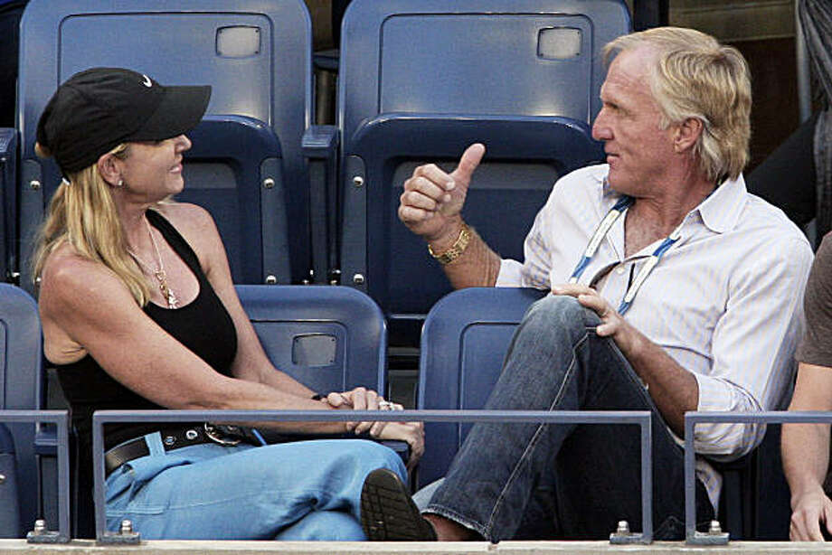 FILE -- This is a Sept. 13, 2009, file photo, showing former tennis player Chris Evert, left, and her husband, golfer Greg Norman, attending the semifinals match between Novak Djokovic  and Roger Federer at the U.S. Open tennis tournament in New York. Just 15 months after they were married, golf star Greg Norman and tennis great Chris Evert announced they have separated. The announcement Friday, Oct. 2, 2009,  comes three days before Norman is to captain the International team at the Presidents Cup in San Francisco, where wives of the captains take on a visible role. (AP Photo/Kathy Willens, File) Photo: Kathy Willens, AP