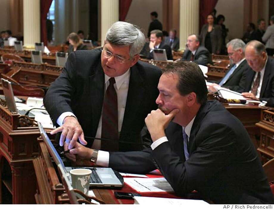 ###Live Caption:State Sen. Mike Machedo, D-Linden, left, goes over his measure to eliminate the California Bay-Delta authority, with Sen. Dennis Hollingsworth, R-Temecula, at the Capitol in Sacramento, Calif., Thursday, May 8, 2008. The measure was approved by a 25-8 bipartisan vote, and sent to the Assembly.(AP Photo/Rich Pedroncelli)###Caption History:State Sen. Mike Machedo, D-Linden, left, goes over his measure to eliminate the California Bay-Delta authority, with Sen. Dennis Hollingsworth, R-Temecula, at the Capitol in Sacramento, Calif., Thursday, May 8, 2008. The measure was approved by a 25-8 bipartisan vote, and sent to the Assembly.(AP Photo/Rich Pedroncelli)###Notes:###Special Instructions: Photo: Rich Pedroncelli