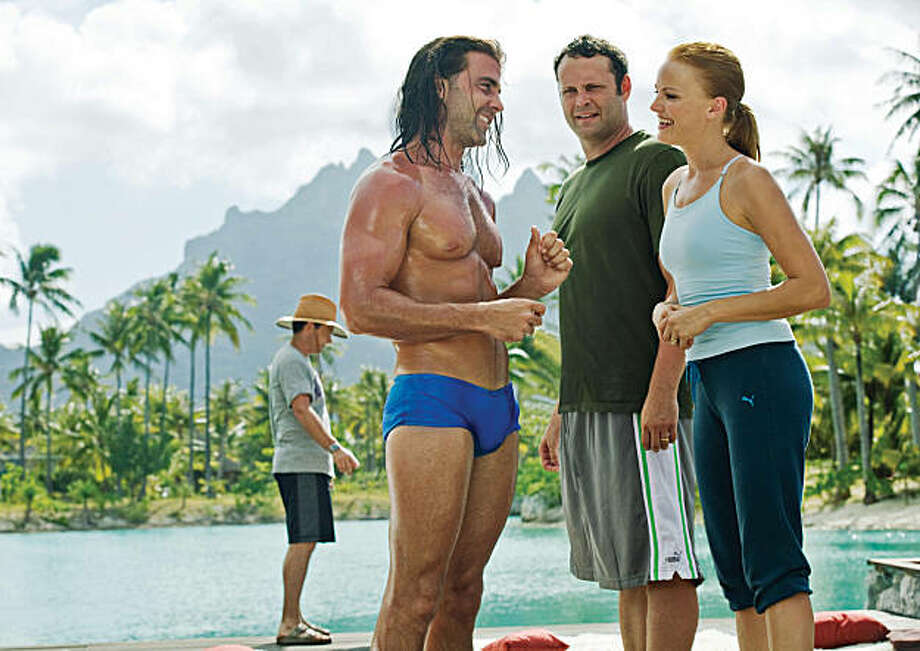 "In this film publicity image released by Universal Pictures, Carlos Ponce, left, Vince Vaughn, center, and Malin Akerman are shown in a scene from ""Couples Retreat."" (AP Photo/Universal Pictures, John Johnson) Photo: John Johnson, AP"