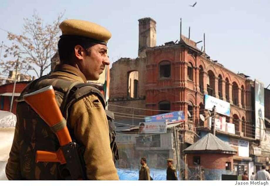 Indian soldier patrols the streets of Srinagar, Kashmir in April, 2008. Photo: By Jason Motlagh