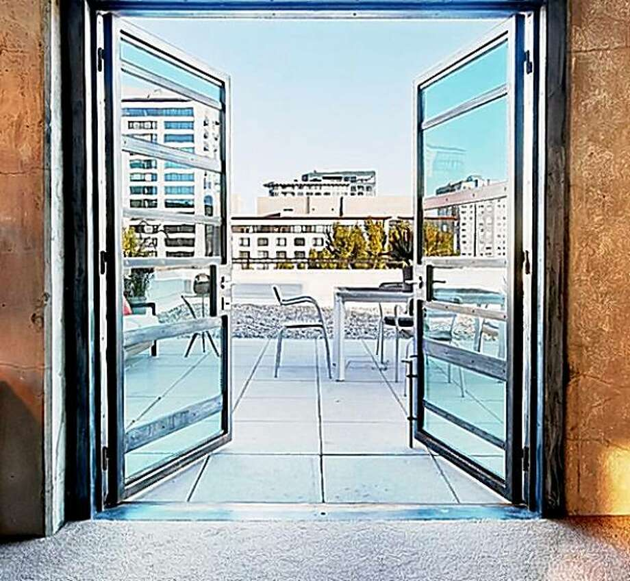 Penthouse doors open to the patio at 601 Fourth Street, San Francisco. Photo: Courtesy, Dan Friedman