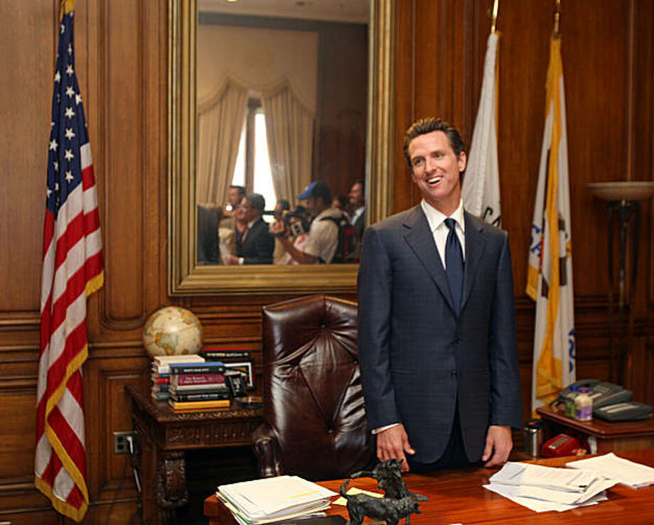 "San Francisco Mayor Gavin Newsom stands at his desk thanking his staff and City Attorney's after learning of the California Supreme Court decision giving Gays and lesbians constitutional right to marry in California.  The state Supreme Court said Wednesday May 15, 2008 in a historic ruling that could be repudiated by the voters in November. In a 4-3 decision, the justices said the state's ban on same-sex marriage violates the ""fundamental constitutional right to form a family relationship. Photo: Lance Iversen, The Chronicle"