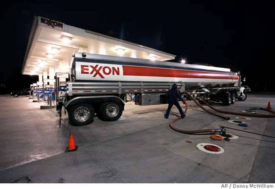 ** FILE ** In this Jan. 27, 2007 file photo, a gasoline tanker delivers fuel to an Exxon station in Keller, Texas. Exxon Mobil said Thursday, May 1, 2008, its earnings for the first three months of the year rose to $10.9 billion, or $2.03 per share, up from $9.3 billion, or $1.62 per share, a year ago. But the latest results fell short of the record $11.7 billion profit Exxon Mobil earned in the final quarter of 2007. (AP Photo/Donna McWilliam, file) Photo: Donna McWilliam