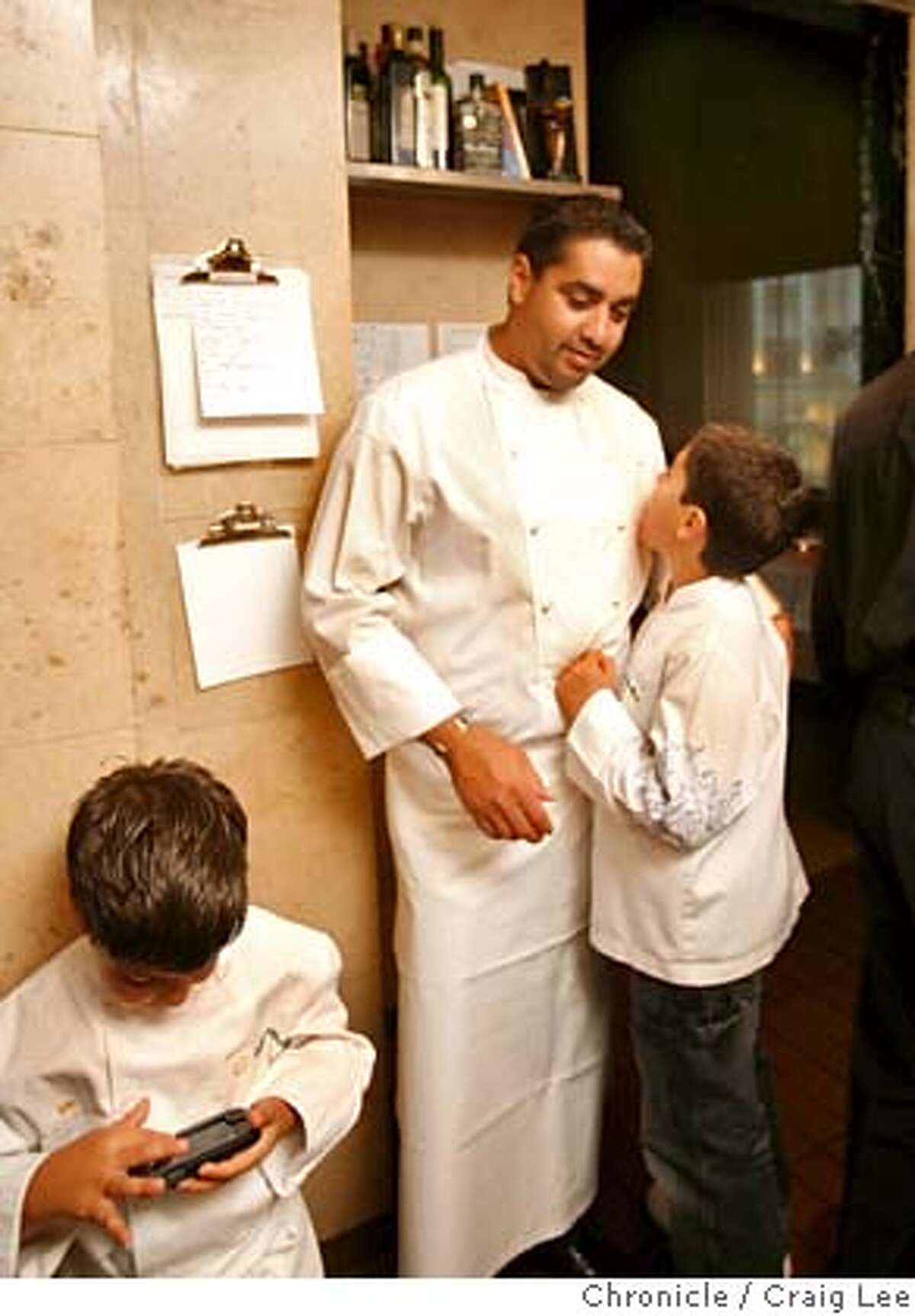 ###Live Caption:4-star chef Michael Mina, with his son's Sammy, 10, and Anthony (left), 6, playing a video game, back in the kitchen at his restaurant, Michael Mina restaurant, in the St. Francis Hotel, San Francisco, Calif., on April 9, 2008. Photo by Craig Lee / The San Francisco Chronicle###Caption History:4-star chef Michael Mina, with his son's Sammy, 10, and Anthony (left), 6, playing a video game, back in the kitchen at his restaurant, Michael Mina restaurant, in the St. Francis Hotel, San Francisco, Calif., on April 9, 2008. Photo by Craig Lee / The San Francisco Chronicle###Notes:Michael Mina restaurant 415-397-9222 Craig Lee 415-218-8597 clee@sfchronicle.com###Special Instructions:MANDATORY CREDIT FOR PHOTOG AND SF CHRONICLE/NO SALES-MAGS OUT
