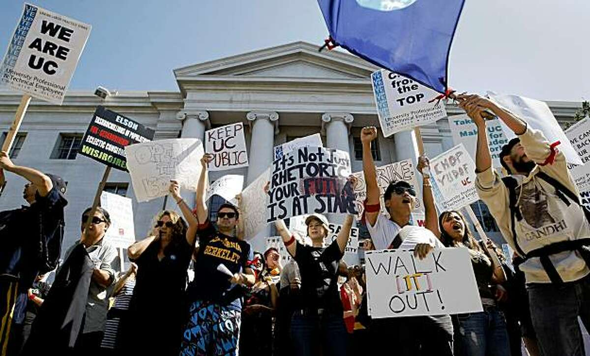 Students and faculty hold a rally at UC Berkeley's Sproul Plaza as they stage a walkout protesting recent budget cuts and fee hikes Wednesday.