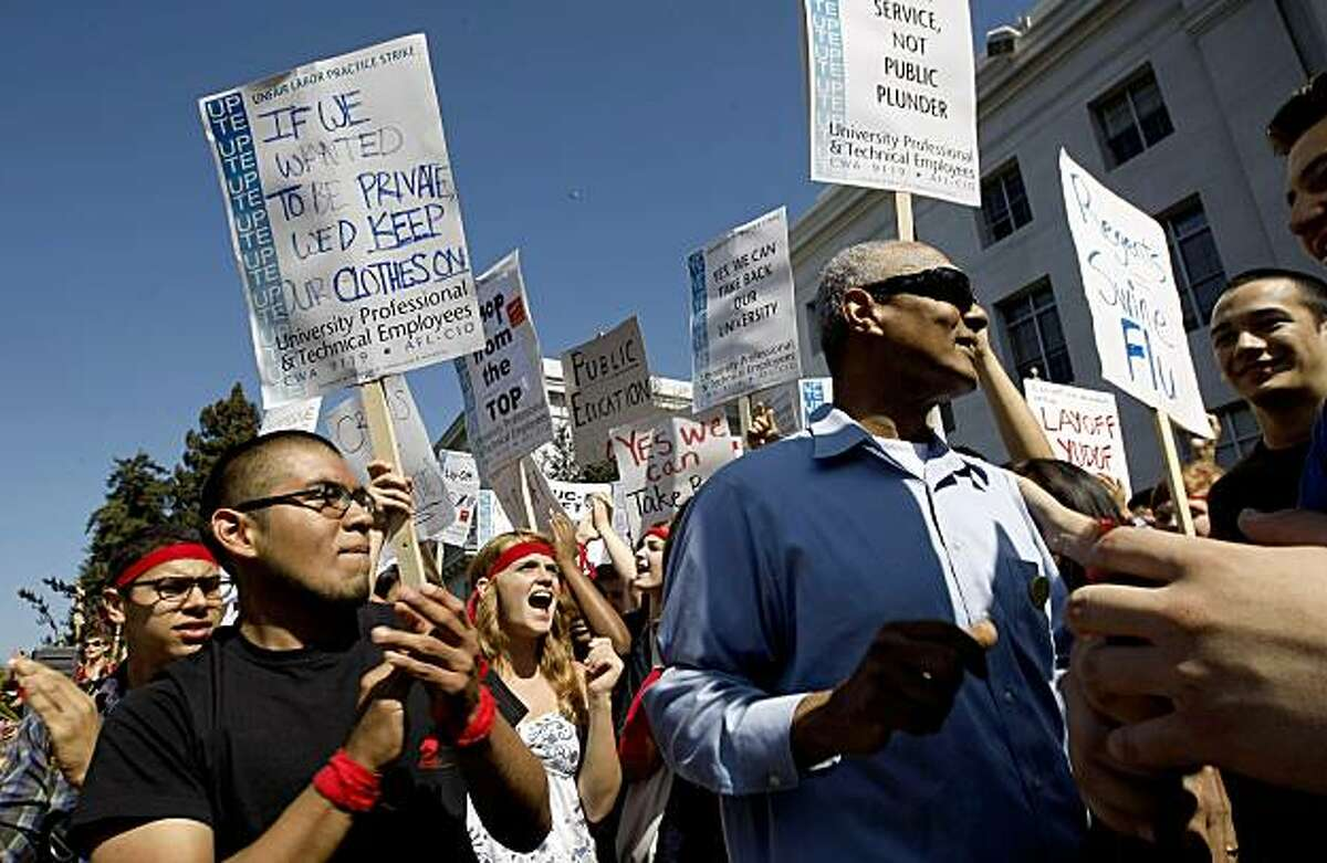 Professor Percy Hintzen (right center), a UC faculty member for 30 years, is applauded after addressing students at Sproul Plaza protesting recent budget cuts and fee hikes to the UC system Wednesday in Berkeley..