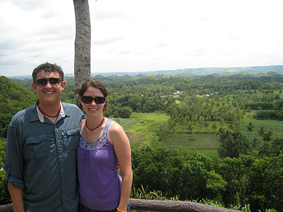 "Michael and Katrina Lappin at the ""Chocolate Hills"" in Bohol. The hills turn brown like chocolate ice cream in the dry season. Photo: N/a"
