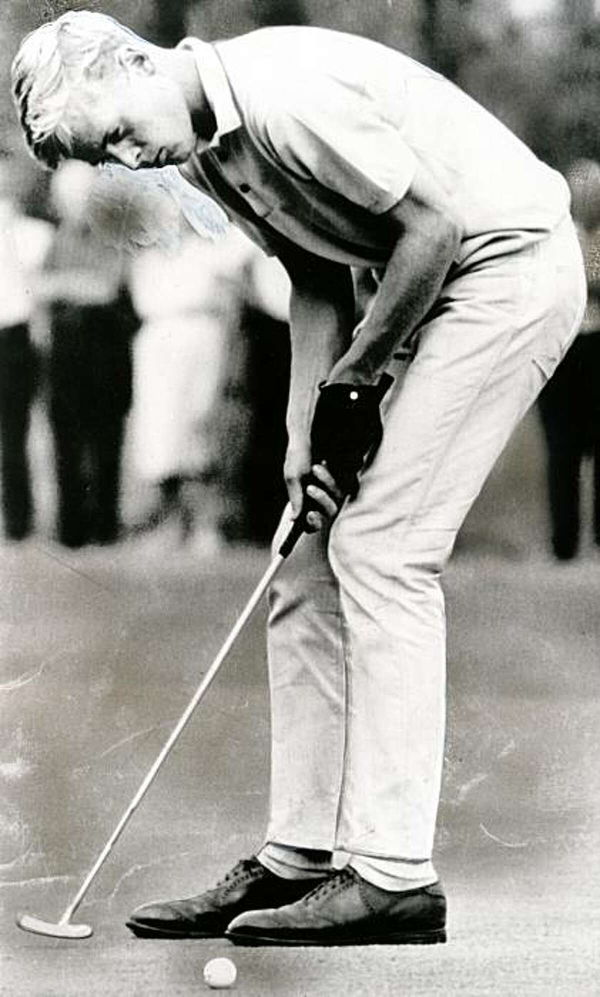 John Miller of San Francisco, playing for the Olympic Club, sinks a short put on the 18th hole of the Eugene Country Club in the qualifying rounds of the 17th Junior Amateur Championship of the United States Golf Association on July 29, 1964.
