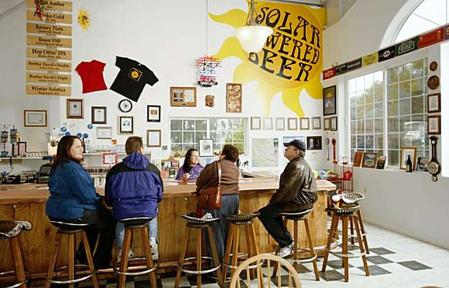 Tasting room at Anderson Valley Brewing Company in Boonville. Photo of left-right at the taste room bar, Connie Arola, and her husband Bruce Arola (from Livermore), Peg Montgomery (serving from behind the bar), Ofra Estes and her husband Stephen Estes (from Pinole). photo by Craig Lee / The Chronicle Photo: Craig Lee, The Chronicle