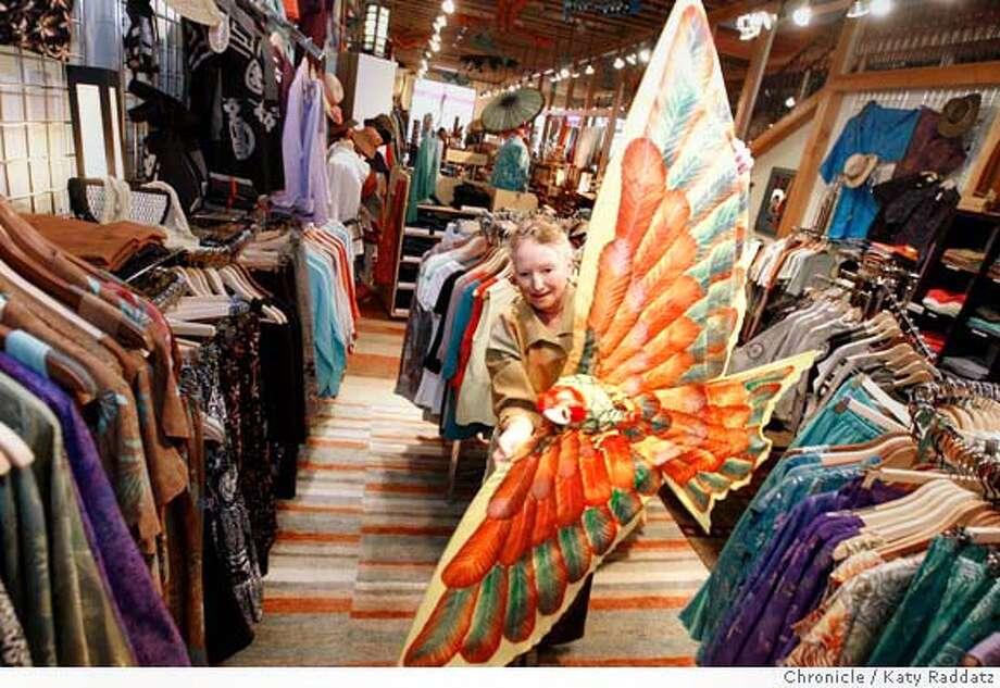 Cecily Beckworth, the manager of Silk Moon, at 186 North Main St. in Sebastopol, Calif. shows a customer a bird kite made by a family in Bali, on Tuesday April 22, 2008.  Photo by Katy Raddatz / San Francisco Chronicle Photo: KATY RADDATZ