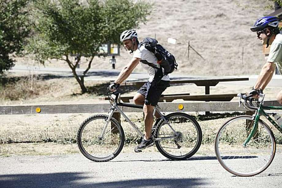 Matt Bissett rides his bike past the part of the Skyline National Trail in Wildcat Canyon Regional Park on Tuesday Sept. 22, 2009 in Berkeley, Calif. Photo: Mike Kepka, The Chronicle