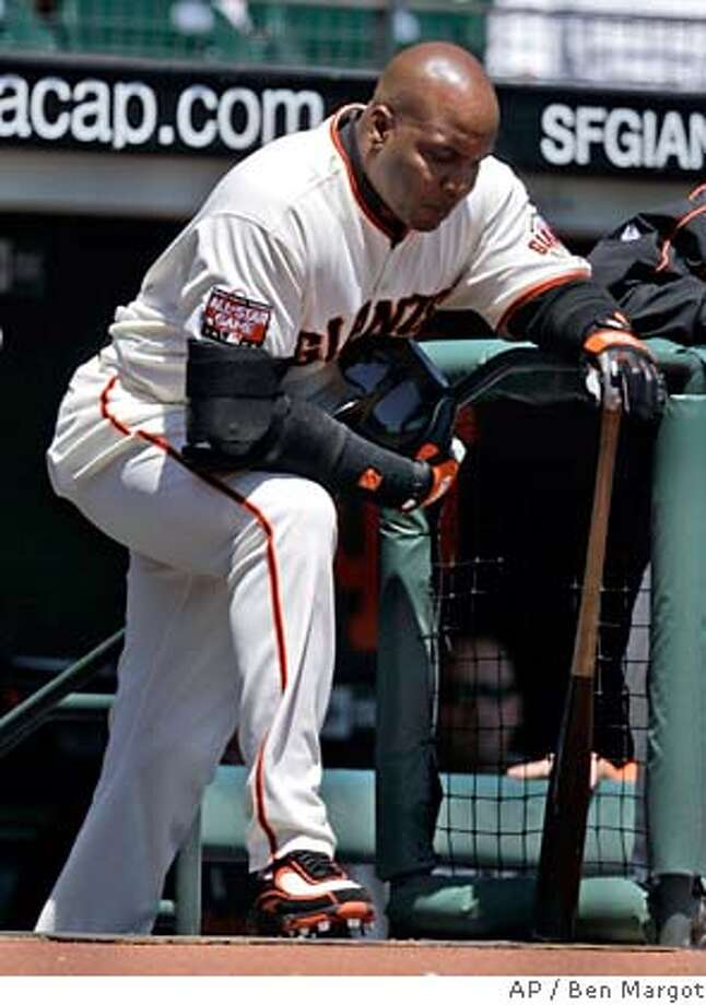San Francisco Giants' Barry Bonds waits to bat against the New York Mets during the first inning of a baseball game Wednesday, May 9, 2007, in San Francisco. (AP Photo/Ben Margot)  Ran on: 05-10-2007  Barry Bonds might be able to market himself as a free-agent designated hitter in the American League next season in the same way Roger Clemens will make guest appearances this year for the Yankees. Photo: Ben Margot