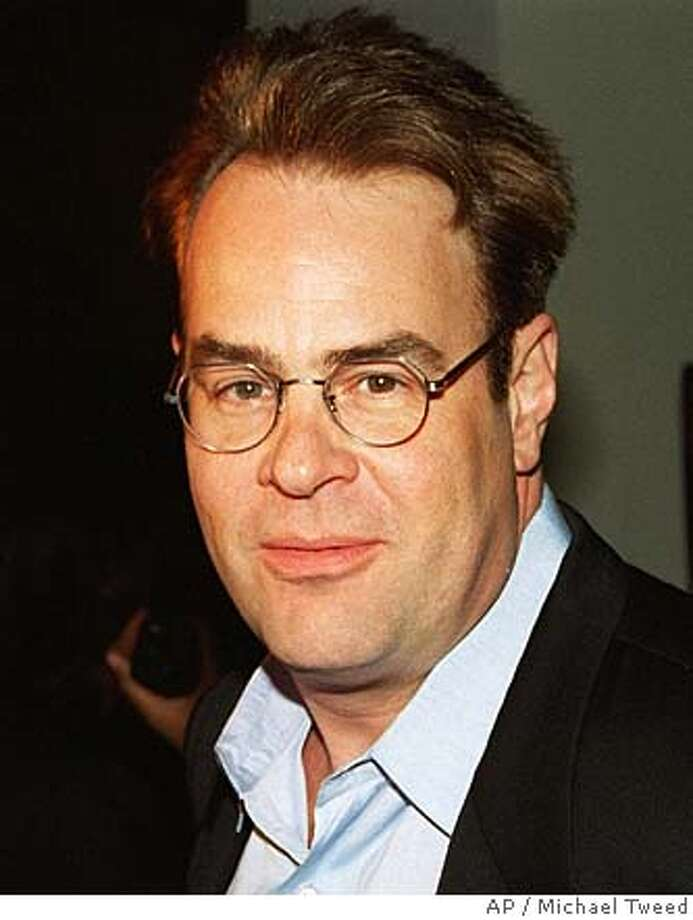 ###Live Caption:AYKROYD-C-07AUG02-DD-AP --- Dan Aykroyd, who plays a crazed Boston Celtics fan in the new film ``Celtic Pride,'' doesn't worry about admirers intruding on him. He has a secret weapon. ``Two words,'' he says in the April 29 issue of People magazine. ``Wood chipper.'' The actor's most memorable encounter with a fan happened while driving through Arkansas. ``I got pulled over by a state trooper who said, `I won't write you a ticket if my buddy can meet you.' He got on his radio and, by the time it was over, there were 10 police cars surrounding me with sirens blaring. Aykroyd is shown in this 1995 file photo.###Caption History:AYKROYD-C-07AUG02-DD-AP --- Dan Aykroyd, who plays a crazed Boston Celtics fan in the new film ``Celtic Pride,'' doesn't worry about admirers intruding on him. He has a secret weapon. ``Two words,'' he says in the April 29 issue of People magazine. ``Wood chipper.'' The actor's most memorable encounter with a fan happened while driving through Arkansas. ``I got pulled over by a state trooper who said, `I won't write you a ticket if my buddy can meet you.' He got on his radio and, by the time it was over, there were 10 police cars surrounding me with sirens blaring. Aykroyd is shown in this 1995 file photo. (AP Photo/files/Micahel Tweed)###Notes:###Special Instructions: Photo: AP Photo/files/Micahel Tweed