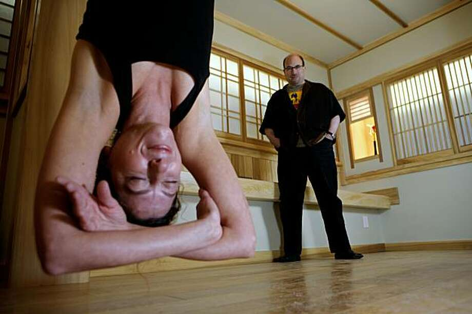 Craig Newmark, founder of Craigslist, and his girlfriend, Eileen Whelpley who is hanging from a yoga inversion swing, show the newly completed yoga room built in Newmark's basement on Friday, Sept. 4, 2009 in San Francisco, Calif. Photo: Russell Yip, The Chronicle