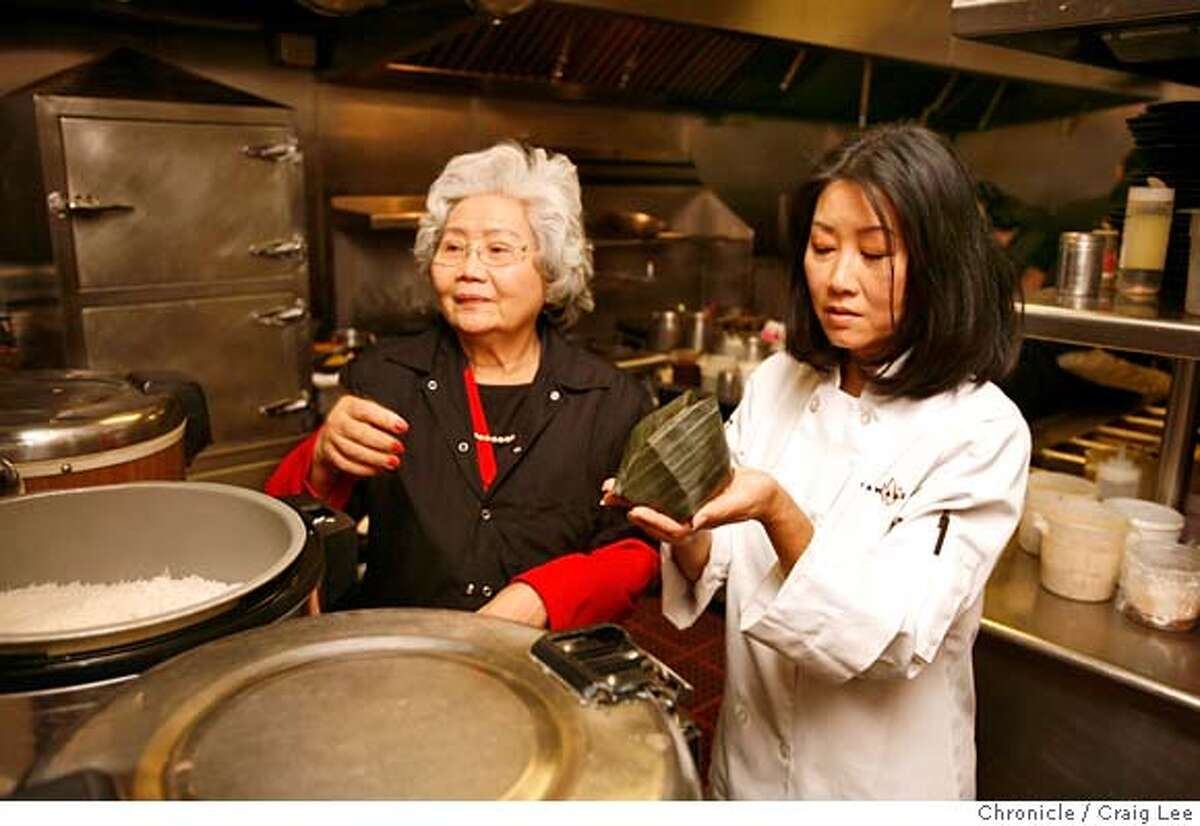 ###Live Caption:Chef Tammy Huynh (right) and her mother, Chac Do (left), wrapping some coconut rice in banana leaves in the kitchen at Tamarine Restaurant in Palo Alto, Calif., on May 2, 2008. Photo by Craig Lee / The San Francisco Chronicle###Caption History:Chef Tammy Huynh (right) and her mother, Chac Do (left), wrapping some coconut rice in banana leaves in the kitchen at Tamarine Restaurant in Palo Alto, Calif., on May 2, 2008. Photo by Craig Lee / The San Francisco Chronicle###Notes:Tamarine Restaurant 650-325-8500 Craig Lee 415-218-8597 clee@sfchronicle.com###Special Instructions:MANDATORY CREDIT FOR PHOTOG AND SF CHRONICLE/NO SALES-MAGS OUT
