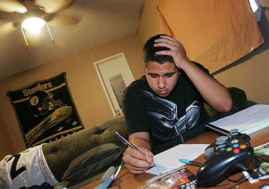 Cameron Hinojosa studies homework and works on resume's at his home Tuesday, Sept. 22, 2009 in Fresno, Calif. More than $1.2 billion in federal stimulus money was supposed to help teenagers find jobs this summer, but the effort barely made a dent in one of the bleakest job markets young workers have faced in more than 60 years. (AP Photo/Gary Kazanjian) Photo: Gary Kazanjian, AP
