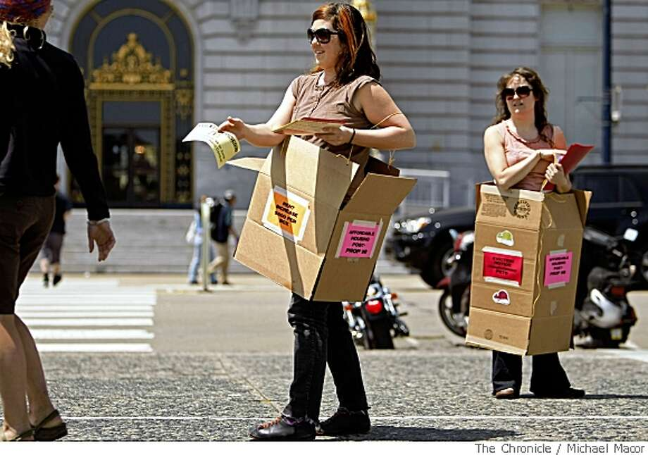 Shannon Rice, center and Kathryn Beeley of San Francsico, pass out flyers on May 7, 2008 in front of San Francsico City Hall, urging no votes on Proposition 98 on the June ballot. They wear boxes to drive the point of what will happen if there is no rent control in the city.Photo by  Michael Macor/ San Francisco Chronicle Photo: Michael Macor, SFC