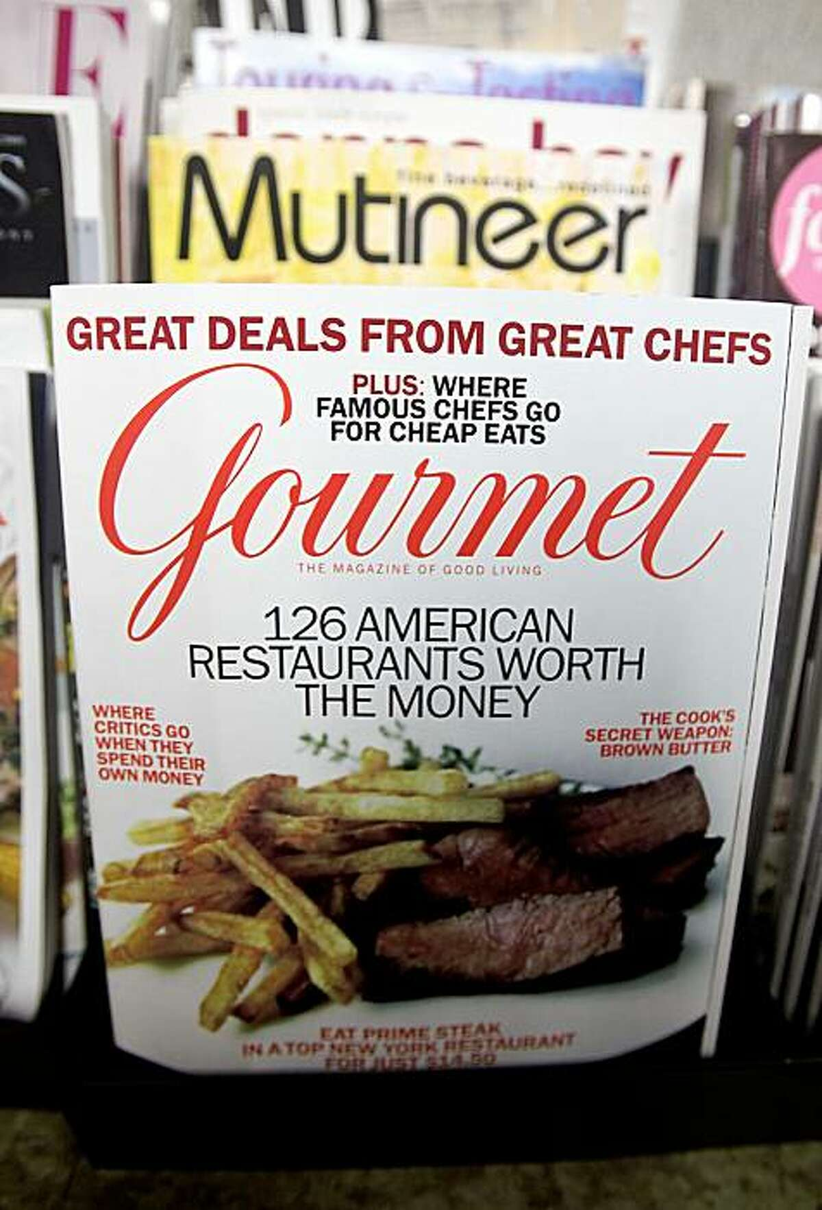 NEW YORK - OCTOBER 05: Copies of Gourmet magazine are displayed on a newsstand October 5, 2009 in New York City. The nation's oldest food magazine is being closed by parent company Conde Nast Publications following dwindling advertising revenues. Conde Nast is also closing Modern Bride, Elegant Bride and Cookie magazines. (Photo by Mario Tama/Getty Images)