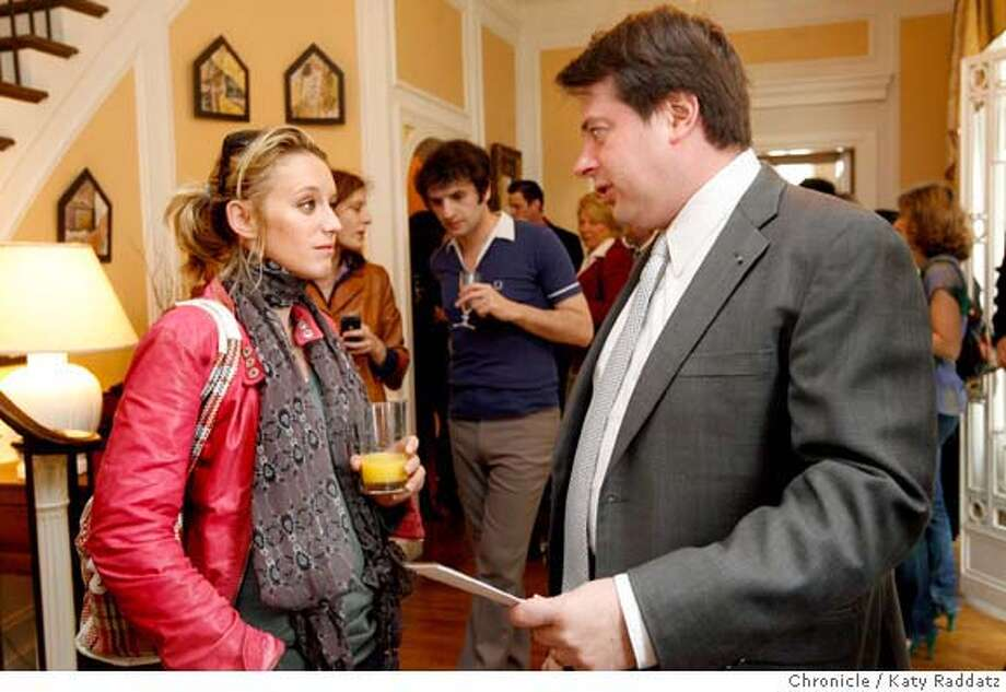 Actress Ludivine Sagnier, left, talks with French Consul General Pierre-Francois Mourier, right, at the party the French Consulate gives every year to honor all the French filmmakers at the SF International Film Festival, in San Francisco, Calif. on Monday, May 5, 2008.  Photo by Katy Raddatz / San Francisco Chronicle  Ran on: 05-07-2008  Ludivine Sagnier, star of &quo;A Girl Cut in Two,&quo; with French Consul General Pierre-Fran�ois Mourier, who threw a party to celebrate the French entries at the S.F. International Film Festival. Photo: KATY RADDATZ