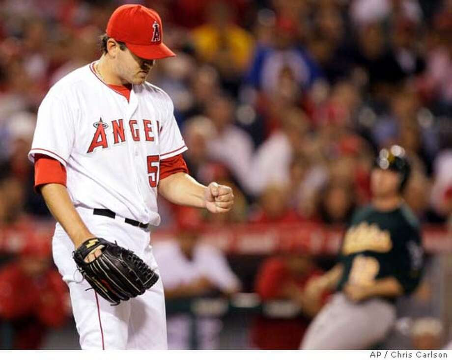 Los Angeles Angels starting pitcher Joe Saunders pumps his fist after Oakland Athletics' Kurt Suzuki grounded out to shortstop Erick Aybar to end the top of the eighth inning of a baseball game in Anaheim, Calif., Tuesday, April 29, 2008. (AP Photo/Chris Carlson) Photo: Chris Carlson