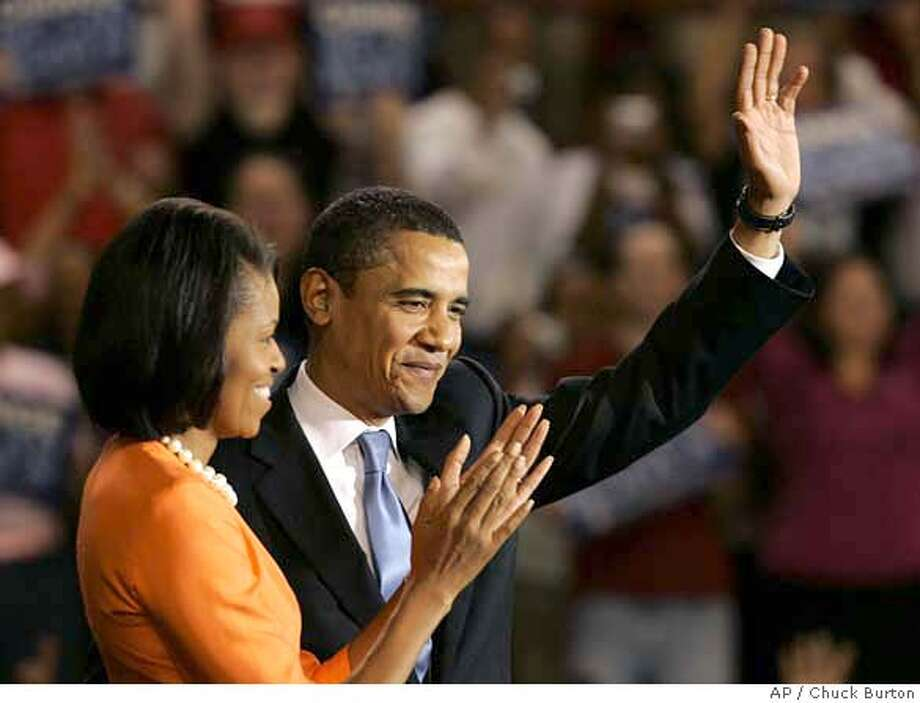 ###Live Caption:Democratic Presidential hopeful, Sen. Barack Obama, D-Ill., right, and his wife Michelle greet supporters in Raleigh, N.C. after Obama won the North Carolina Democratic presidential primary election on Tuesday, May 6, 2008. (AP Photo/Chuck Burton)###Caption History:Democratic Presidential hopeful, Sen. Barack Obama, D-Ill., right, and his wife Michelle greet supporters in Raleigh, N.C. after Obama won the North Carolina Democratic presidential primary election on Tuesday, May 6, 2008. (AP Photo/Chuck Burton)###Notes:###Special Instructions: Photo: Chuck Burton