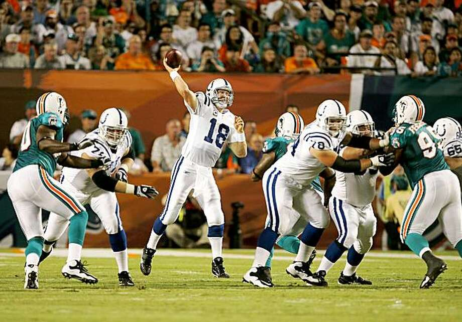 MIAMI - SEPTEMBER 21:  Quarterback Peyton Manning #18 of the Indianapolis Colts throws a touchdown pass to tight end Dallas Clark #44 on the first play from scrimmage against the Miami Dolphins at Land Shark Stadium on September 21, 2009 in Miami, Florida.  (Photo by Doug Benc/Getty Images) Photo: Doug Benc, Getty Images