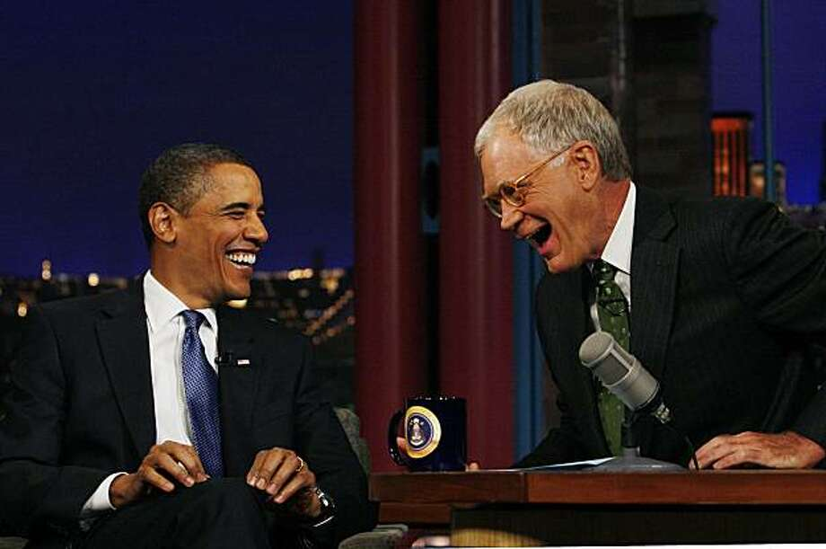 President Barack Obama is pictured with host David Letterman during a break at a taping of CBS The Late Show with David Letterman, Monday, Sept. 21, 2009, at the Ed Sullivan Theater in New York. (AP Photo/Charles Dharapak) Photo: Charles Dharapak, AP