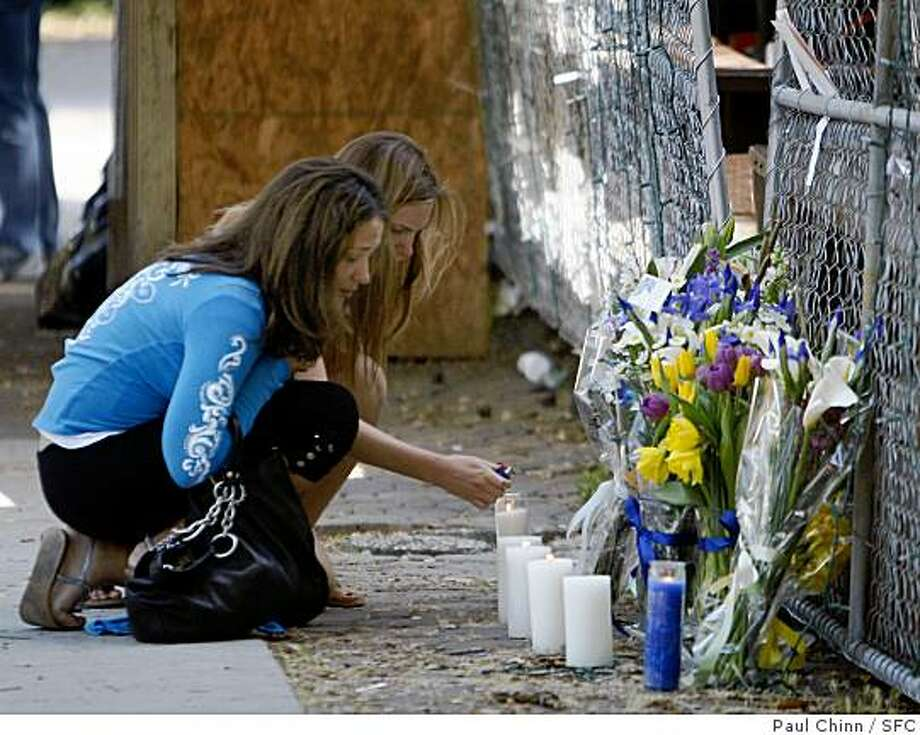 Mourners light candles at a memorial arranged in front of Sigma Pi fraternity in Berkeley, Calif., on Saturday, May 3, 2008. Police say a 21-year-old Cal student, a member of Sigma Pi, was stabbed to death in a sorority house parking lot two doors away. Police have announced an arrest in the slaying.Photo by Paul Chinn / San Francisco Chronicle Photo: Paul Chinn, SFC