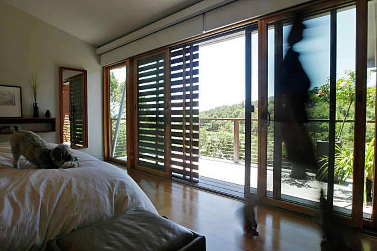 Architect Michelle Kaufmann's bedroom with wooden sunshades that runs through the house to conserve the temperture inside her sustainable home, Thursday June 11, 2009, in Novato, Calif.