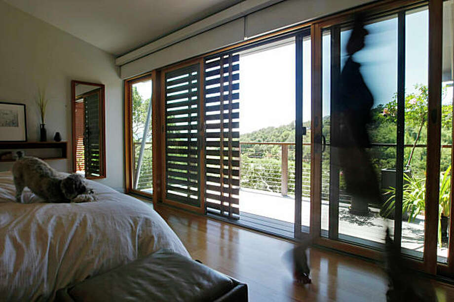 Architect Michelle Kaufmann's bedroom with wooden sunshades that runs through the house to conserve the temperture  inside her sustainable home, Thursday June 11, 2009, in Novato, Calif. Photo: Lacy Atkins, The Chronicle / SFC