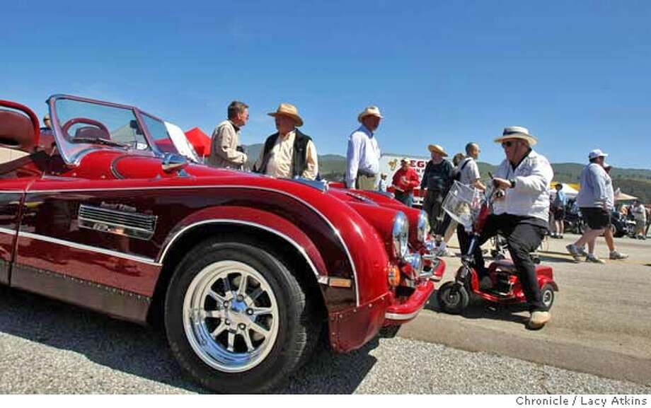 ###Live Caption:Jim Anderson of Sunnydale looks over the 1952 Jaguar XK120 at the Pacific Coast Dream Machine show, Sunday April 27, 2008, in Half Moon Bay, Calif.  Lacy Atkins / San Francisco Chronicle###Caption History:Jim Anderson of Sunnydale looks over the 1952 Jaguar XK120 at the Pacific Coast Dream Machine show, Sunday April 27, 2008, in Half Moon Bay, Calif.  Lacy Atkins / San Francisco Chronicle###Notes:###Special Instructions:MANDATORY CREDIT FOR PHOTOG AND SAN FRANCISCO CHRONICLE/NO SALES MAGS OUT Photo: Lacy Atkins