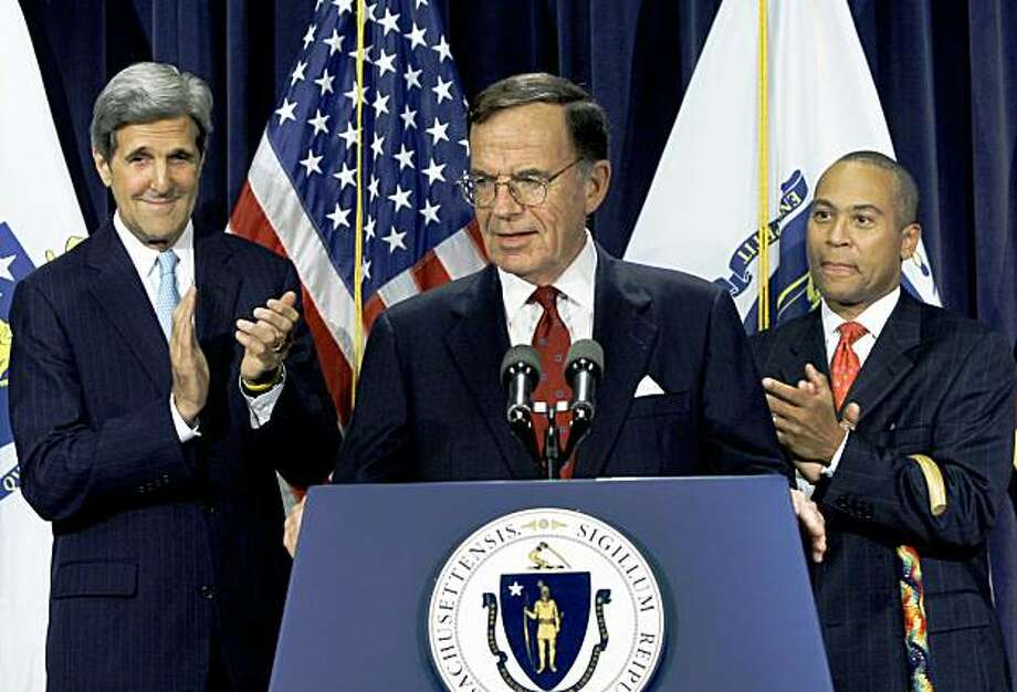 Former Democratic Party chairman Paul G. Kirk Jr. takes the podium as Sen. John Kerry, D-Mass., left, and Mass. Gov. Deval Patrick, right, applaud during a news conference at the Statehouse in Boston Thursday, Sept.24, 2009 where Patrick announced that Kirk will temporarily fill the late Sen. Edward Kennedy's U.S. Senate seat. (AP Photo/Elise Amendola) Photo: Elise Amendola, Associated Press