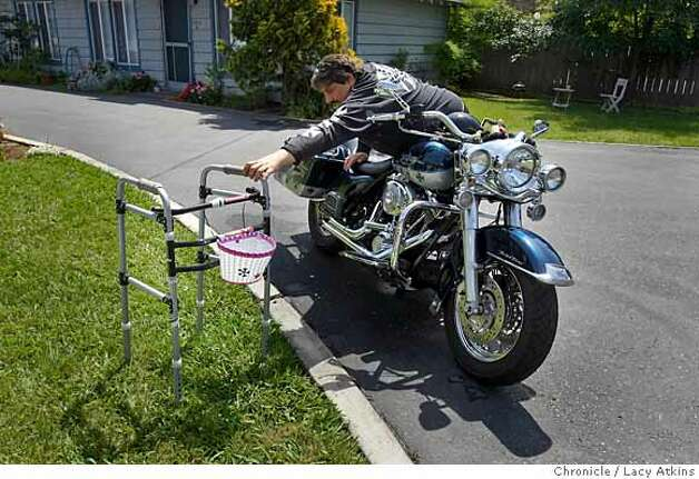 Bob Lupo reaches for his walker after riding his 2002 Harley Davidson for the first time since having his hip replacement surgery, Monday April 28, 2008, in Santa Rosa, Calif. After he was in a motorcycle accident he needed a hip replacement, because of being price and being uninsured he went to India for his transplant.  Lacy Atkins / San Francisco Chronicle  Ran on: 05-04-2008  Robert Lupo reaches for his walker after riding his motorcycle for the first time since having hip-replacement surgery in India. Photo: Lacy Atkins