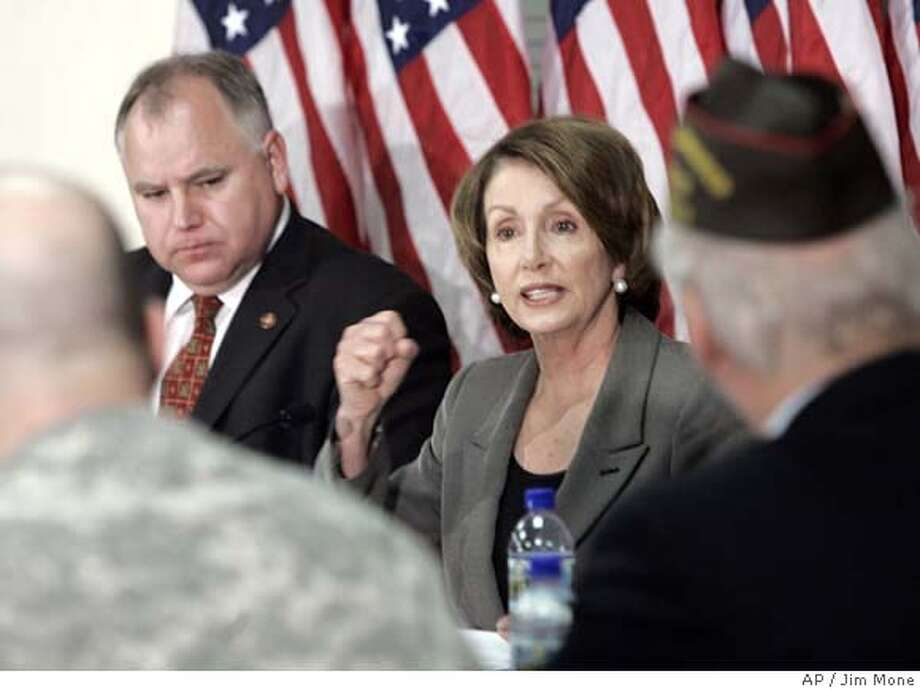 ###Live Caption:House Speaker Nancy Pelosi stresses a point as Rep. Tim Walz, D-Minn., left, listens during a public veterans forum at the Minneapolis Veterans Administration Medical Center Monday, April 21, 2008 in Minneapolis. (AP Photo/Jim Mone)###Caption History:House Speaker Nancy Pelosi stresses a point as Rep. Tim Walz, D-Minn., left, listens during a public veterans forum at the Minneapolis Veterans Administration Medical Center Monday, April 21, 2008 in Minneapolis. (AP Photo/Jim Mone)###Notes:Nancy Pelosi, Tim Walz###Special Instructions: Photo: Jim Mone