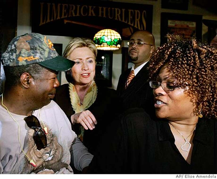 ###Live Caption:Democratic presidential hopeful Sen. Hillary Rodham Clinton, D-N.Y., greets patrons during a campaign stop at Bennigan's Restaurant in Gary, Ind., Friday, April 25, 2008. (AP Photo/Elise Amendola)###Caption History:Democratic presidential hopeful Sen. Hillary Rodham Clinton, D-N.Y., greets patrons during a campaign stop at Bennigan's Restaurant in Gary, Ind., Friday, April 25, 2008. (AP Photo/Elise Amendola)###Notes:Hillary Rodham Clinton###Special Instructions: Photo: Elise Amendola