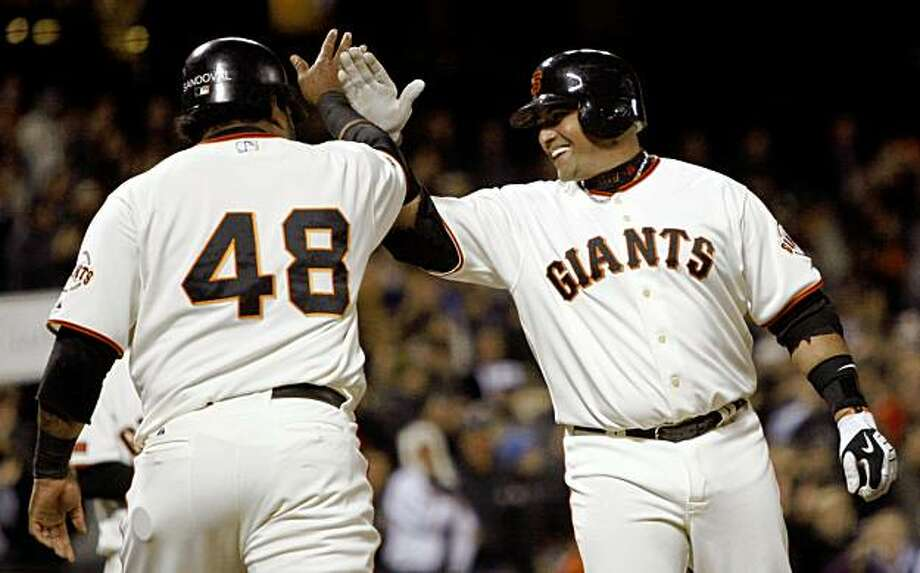 San Francisco Giants' Bengie Molina, right, celebrates with teammate Pablo Sandoval (48) after hitting a two-run home run off Arizona Diamondbacks' Doug Davis in the fourth inning of a baseball game Tuesday, Sept. 29, 2009, in San Francisco. (AP Photo/Ben Margot) Photo: Ben Margot, AP
