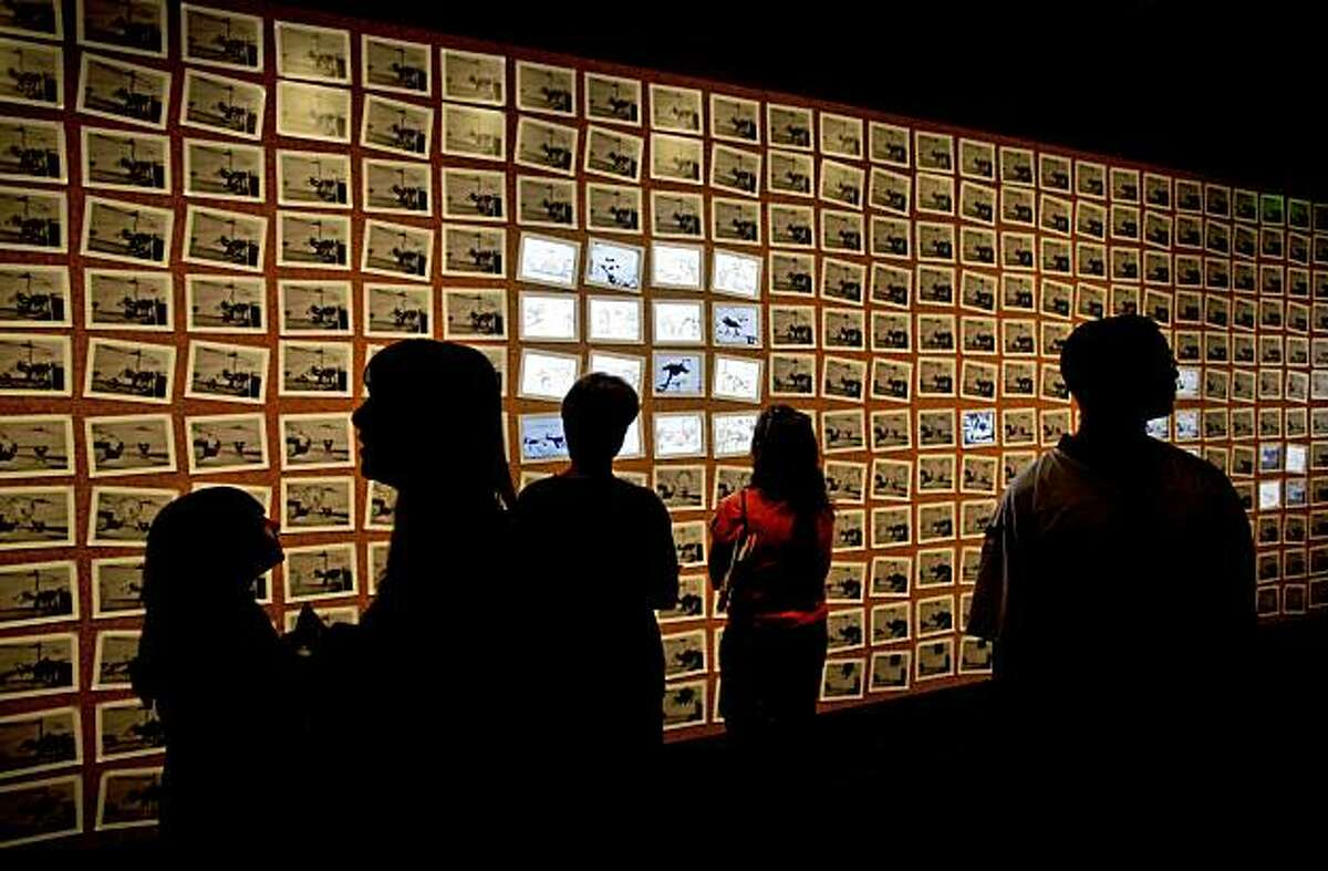 Visitors explore the 348 frames used to create the animated cartoon,