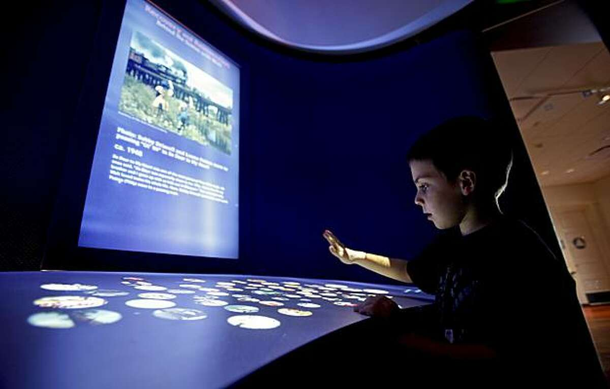 Josh Tanner, 5-years-old from Pacifica, gets into an interactive display inside gallery 7, which shows the post war years of Disney, during the grand opening of the Disney Family Museum on Thursday October 1, 2009 in San Francisco, Calif.