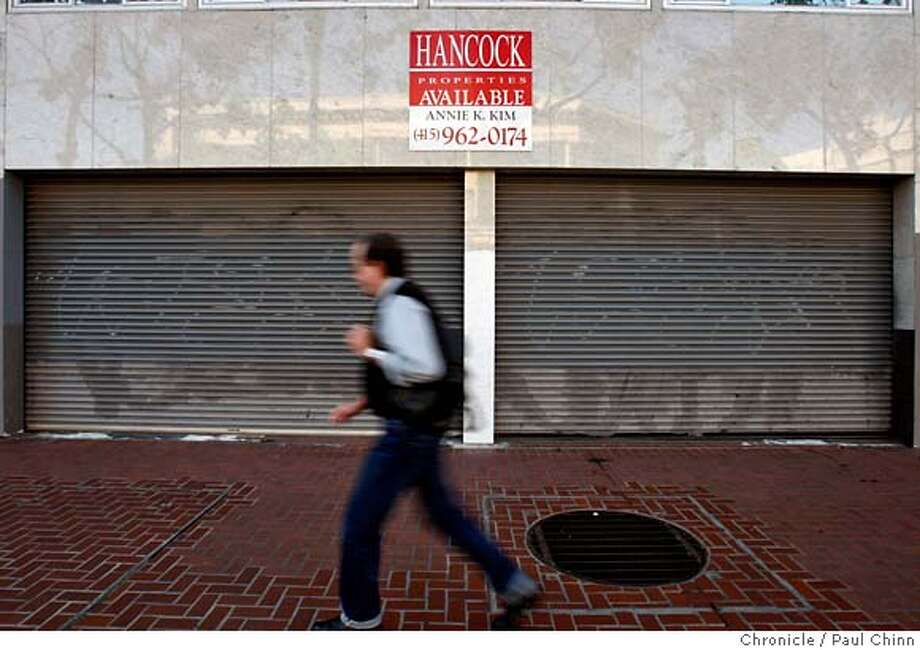 ###Live Caption:A man walks past vacant retail space at 1061 Market Street in San Francisco, Calif., on Friday, April 25, 2008. Millions of dollars of redevelopment funds earmarked to spruce up the neighborhood has been tied up in political limbo and may go to waste.  Photo by Paul Chinn / San Francisco Chronicle###Caption History:A man walks past vacant retail space at 1061 Market Street in San Francisco, Calif., on Friday, April 25, 2008. Millions of dollars of redevelopment funds earmarked to spruce up the neighborhood has been tied up in political limbo and may go to waste.  Photo by Paul Chinn / San Francisco Chronicle###Notes:###Special Instructions:MANDATORY CREDIT FOR PHOTOGRAPHER AND S.F. CHRONICLE/NO SALES - MAGS OUT Photo: Paul Chinn