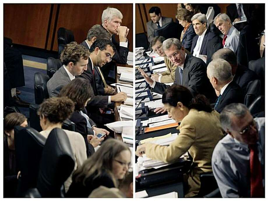Staff members, left, work as the Senate Finance Committee, right, meets for a second day on a nearly $900 billion, 10-year health care reform bill in Washington on Wednesday, Sept. 23, 2009. Republicans argued the health legislation would hurt seniors and Democrats said it would do nothing of the sort as the committee resumed debate Wednesday. (Stephen Crowley/The New York Times) Photo: STEPHEN CROWLEY, NYT