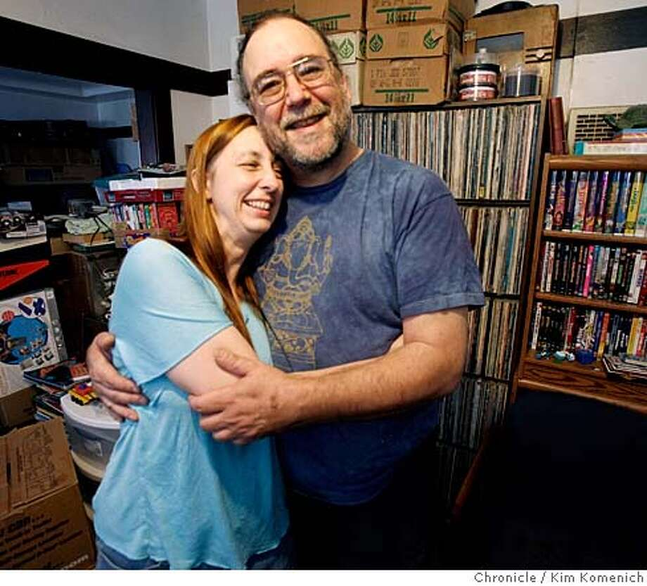 "Sue McCullough and Donald Barks got together 20 years ago because of a ""mixtape"", a collection of their favorite songs collected on a cassette tape. They are photographed in their Oakland, Calif. home on Saturday, April 12, 2008. Photo by Kim Komenich / San Francisco Chronicle  Ran on: 04-27-2008  Sue McCullough and Donald Barks got together 20 years ago with the help of a mix tape.  Ran on: 04-27-2008 Photo: Kim Komenich"