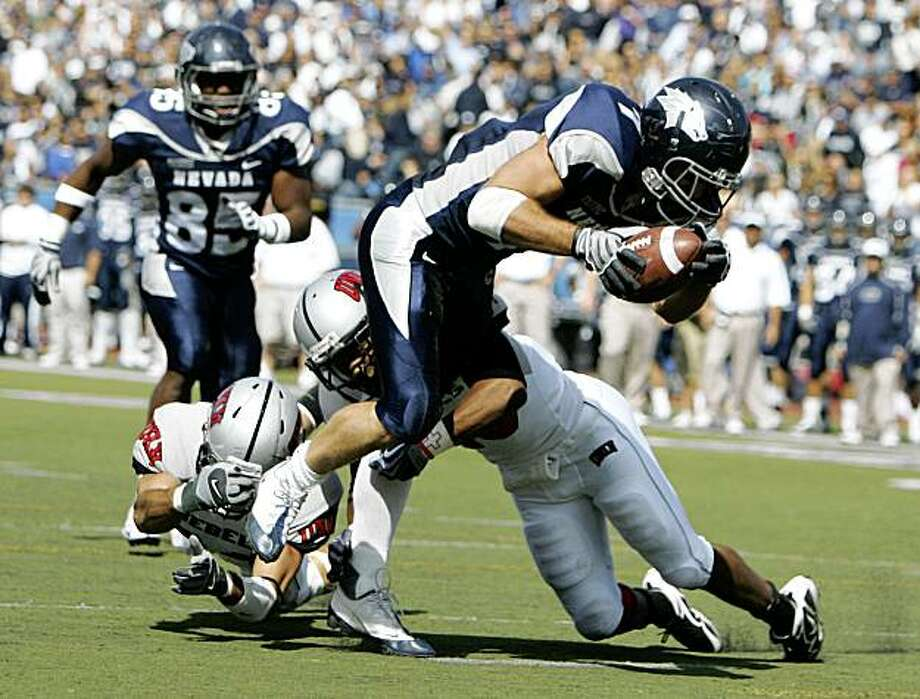 Nevada's Luke Lippincott rushes past UNLV's John Therell during the first half of their NCAA college football game at Mackay Stadium in Reno, Nev., on Saturday, Oct. 3, 2009. (AP Photo/Brad Horn) Photo: Brad Horn, AP
