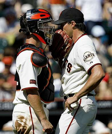 Barry Zito talks to catcher Buster Posey during a rough third inning as he faced nine batters against the Chicago Cubs. Photo: Frederic Larson, The Chronicle