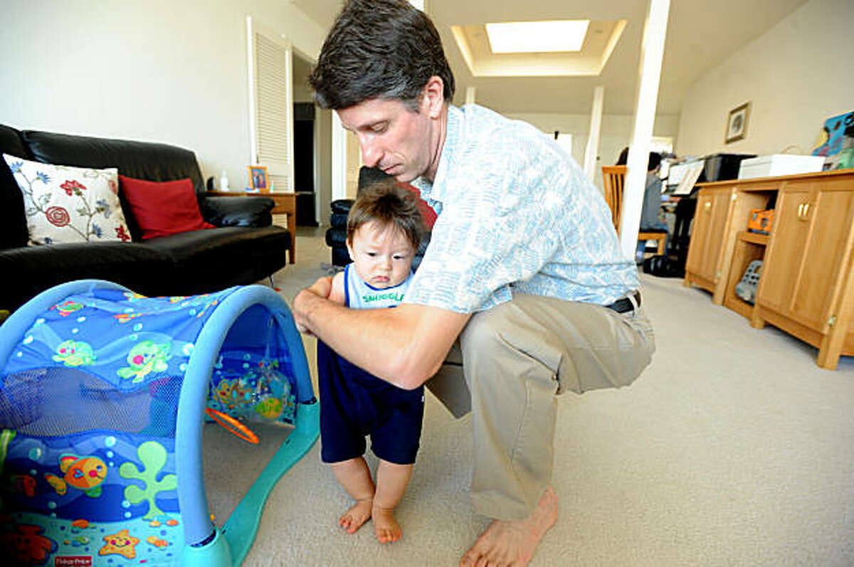 Wayne Volkmuth spends time with his 8-month-old son Ian at their Foster City, Calif., home on Saturday, Sept. 19, 2009. Volkmuth's son Ryan died three years ago while undergoing a dental procedure at a Palo Alto clinic.