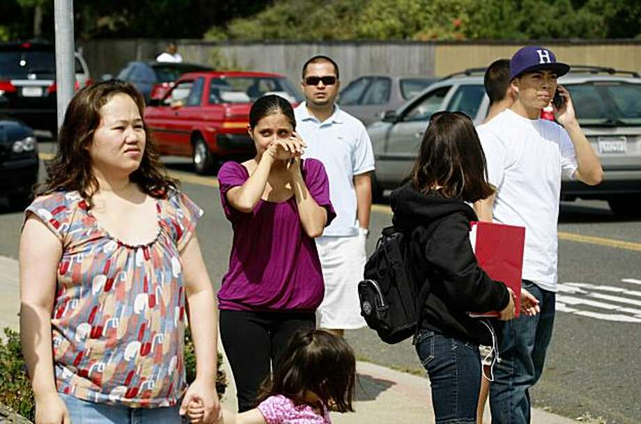 People watch along College Avenue near Skyline College in San Bruno, Calif. where a shooting occurred on Wednesday, September 2, 2009. Photo: Lea Suzuki, The Chronicle