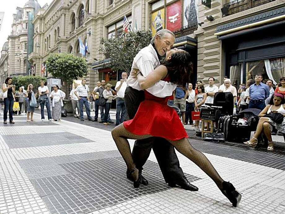 Argentinian professional tango dancers perform at Florida street, in Buenos Aires downtown, 21 January 2008. AFP PHOTO/JUAN MABROMATA (Photo credit should read JUAN MABROMATA/AFP/Getty Images) Photo: Juan Mabromata, AFP/Getty Images