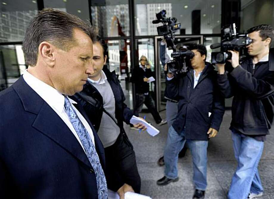 Michael David Barrett's attorney Rick Beuke, left, speaks to the media after Barrett appeared for a hearing at the Dirksen Federal Courthouse in Chicago, Saturday, Oct. 3, 2009. The Chicago-area man accused of filming surreptitious nude videos of ESPN reporter Erin Andrews in a hotel room was arrested at Chicago's O'Hare airport Friday night. (AP Photo/Paul Beaty) Photo: Paul Beaty, AP